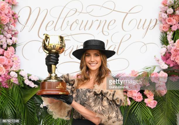 Rachael Finch poses with the Melbourne Cup during the Melbourne Cup Carnival Launch at Flemington Racecourse on October 30 2017 in Melbourne Australia
