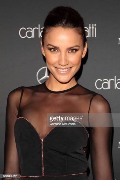 Rachael Finch wearing an outfit by Bec Bridge attends the Carla Zampatti show during MercedesBenz Fashion Week Australia 2014 at Carriageworks on...
