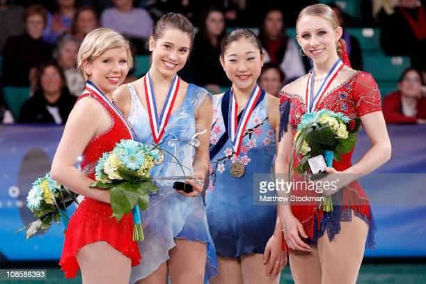 Rachael Flatt Alissa Czisny Mirai Nagasu and Agnes Zawadski pose for photographers after the Championship Ladies competition during the US Figure...