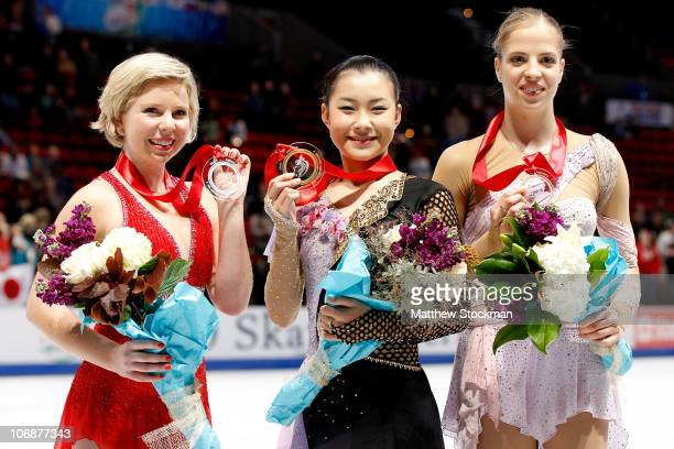 Rachael Flatt Kanako Murakami of Japan and Carolina Kostner of Italy pose for photographers after the Ladies competition during Skate America at Rose...