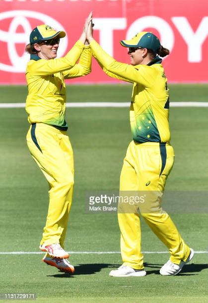 Rachael Haynes of Australia celebrates after taking a catch to dismiss Hayley Jensen of New Zealand off the bowling Megan Schutt of Australia to win...