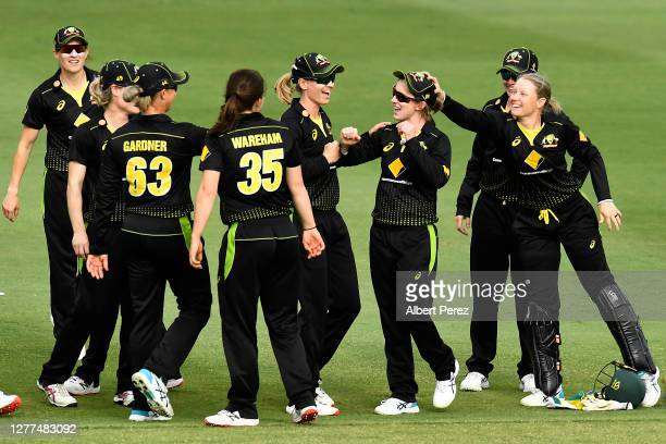 Rachael Haynes of Australia celebrates with team mates after running out Suzie Bates of New Zealand during game three of the T20 International series...