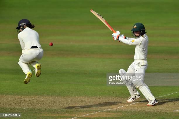Rachael Haynes of Australia plays a shot past Fran Wilson of England during the Kia Women's Test Match between England Women and Australia Women at...