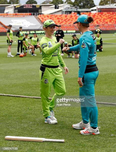 Rachael Haynes of the Thunder and Jess Jonassen of the Heat flip the bat during the Women's Big Bash League WBBL match between the Sydney Thunder and...