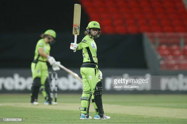 Rachael Haynes of the Thunder celebrates after reaching her half century during the Women's Big Bash League WBBL match between the Sydney Thunder and...