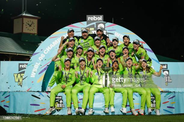 Rachael Haynes of the Thunder lifts the trophy as the Thunder celebrate victory during the Women's Big Bash League Final between the Melbourne Stars...