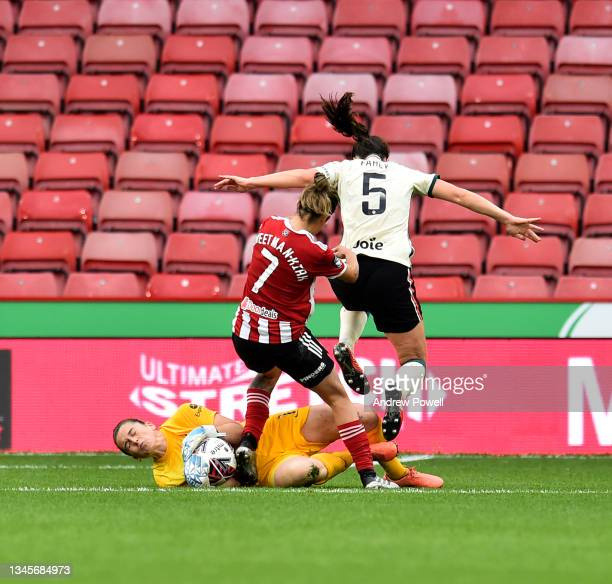 Rachael Laws of Liverpool Women with Courtney Sweetman-Kirk of Sheffield United Women during the Barclays FA Women's Championship match between...