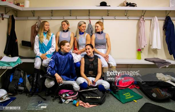 Rachael Murray Rhiannon Payne Louise Day Mikayla Weir Wendy Peel and Brooke Stower pose for a photo in the jockeys room during racing at Muswellbrook...