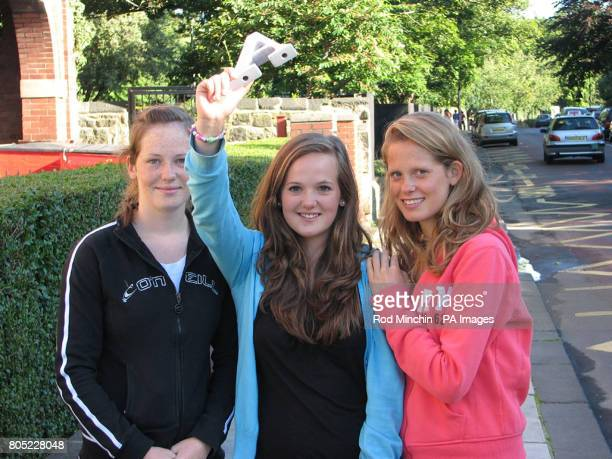 Rachael Oswald celebrates her GCSE results at Church High School in Jesmond Newcastle with her older sisters Sarah and Anna