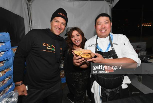 Rachael Ray and Blue Moon's People's Choice Award winner Chef Eric Rentz pose with his signature burger 'The Double Smash' during the Food Network...