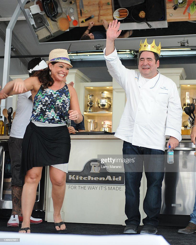 Rachael Ray and Emeril Lagasse attend the Whole Foods Grand Tasting Village at the 2012 South Beach Wine and Food Festival on February 25, 2012 in Miami Beach, Florida.