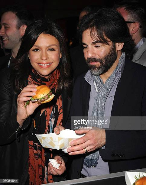 Rachael Ray and her husband John Cusimano attend the Amstel Light Burger Bash at Ritz Carlton South Beach on February 25 2010 in Miami Beach Florida