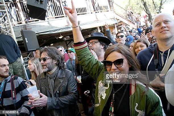 Rachael Ray and husband John Cusimano watch bands perform during Rachael Ray's Feedback party at Stubbs BBQ during the South by Southwest Music...