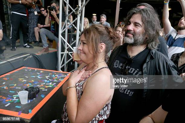 Rachael Ray and John Cusimano watch SaltNPepa perform in concert at Stubbs BBQ during South By Southwest at The Feedback House on March 15 2018 in...