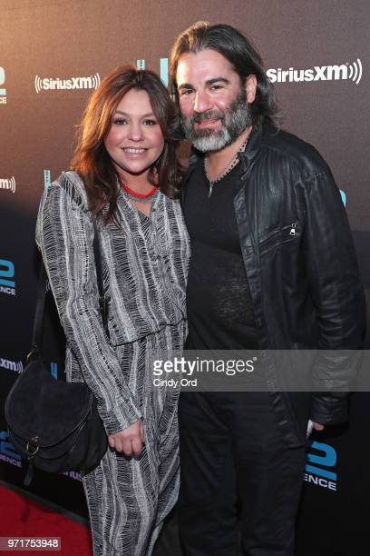 Rachael Ray and John M Cusimano attend SiriusXM's private concert with U2 at The Apollo Theater as the band takes a one night detour from the...