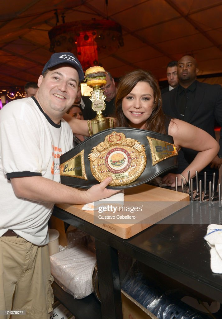 Rachael Ray (R) attends Amstel Light Burger Bash presented by Pat LaFrieda Meats hosted by Rachael Ray during the Food Network South Beach Wine & Food Festival at Beachside at The Ritz Carlton on February 21, 2014 in Miami Beach, Florida.