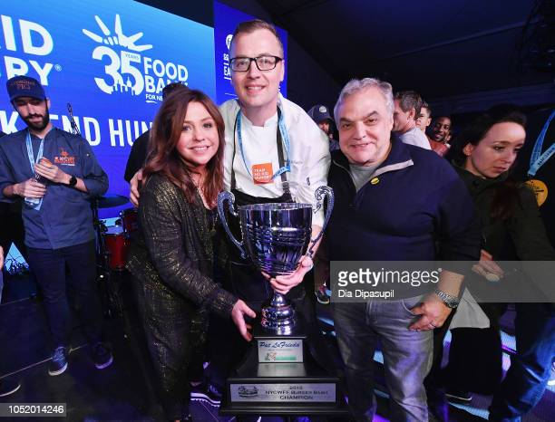Rachael Ray award winner Chef Patrick Schaeffer and Lee Schrager pose with the Pat LaFrieda 2018 NYCWFF Burger Bash Champion trophy for his signature...