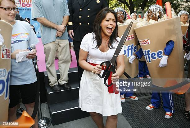 Rachael Ray cuts a ribbon kicking off Dunkin' Donuts' inaugural Running Of The Cups to celebrate those that serve the community at Herald Square July...