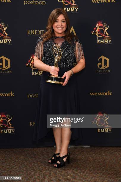 Rachael Ray poses with the Daytime Emmy Award for Outstanding Informative Talk Show Host in the press room during the 46th annual Daytime Emmy Awards...