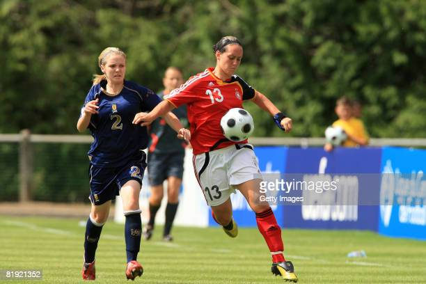 Rachael Small of Scotland and Lisa Schwab of Germany fight for the ball during the Women's U19 European Championship match between Scotland and...