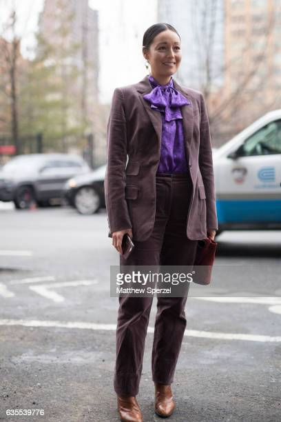 Rachael Wang is seen attending Michael Kors during New York Fashion Week wearing brown sport coat and pants with purple top on February 15 2017 in...