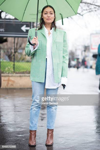 Rachael Wang poses after the Balenciaga show at the Centre Champerret during Paris Fashion Week Womenswear FW 17/18 on March 5 2017 in Paris France