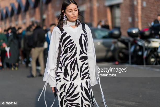 Rachael Wang wearing a black white zebra dress outside Gucci on February 22 2017 in Milan Italy