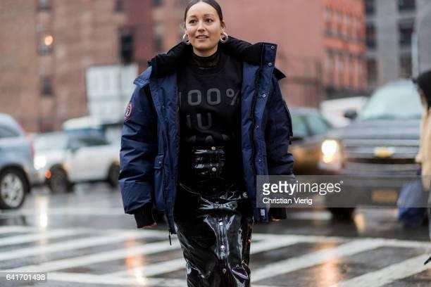 Rachael Wang wearing a navy parka black knit vinyl pvc skirt outside Diane von Furstenberg on February 12 2017 in New York City