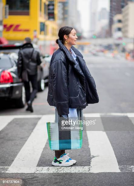 Rachael Wang wearing puffer jacket bag sneakers seen outside SelfPortrait on February 10 2018 in New York City