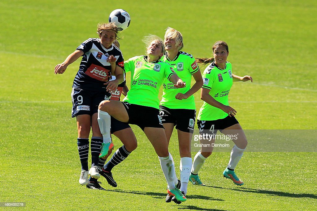 Racheal Quigley of the Victory (L) heads the ball surrounded by the United defence during the W-League Semi Final match between Melbourne Victory and Canberra United at Simonds Stadium on December 13, 2014 in Geelong, Australia.