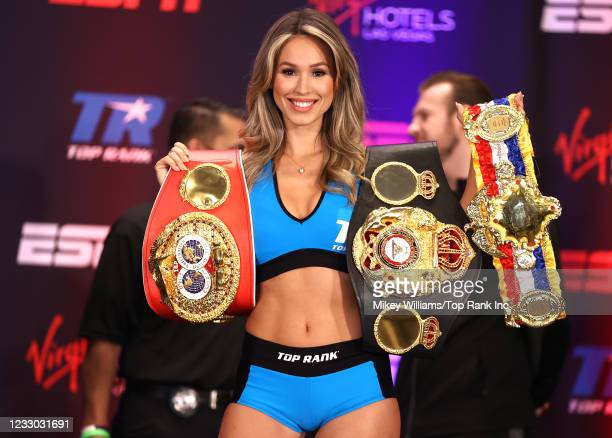Rachel Anne Cook poses with the world titles during the Jose Ramirez v. Josh Taylor weigh in at Virgin Hotels Las Vegas on May 21, 2021 in Las Vegas,...