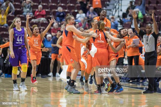 May 7: Rachel Banham of the Connecticut Sun is congratulated by team mates after her long range buzzer beater won the game as Karlie Samuelson of the...