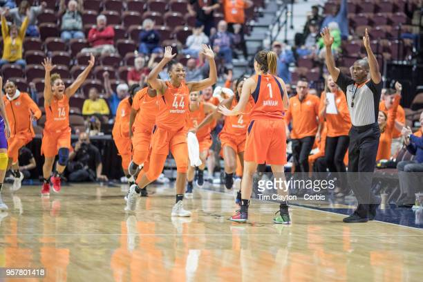 Rachel Banham of the Connecticut Sun is congratulated by team mates after her long range buzzer beater won the game during the Connecticut Sun Vs Los...