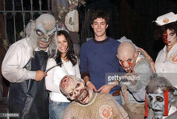 Rachel Bilson and Adam Brody with Asylum ghouls during Cast of 'The OC' Visits Knott's Scary Farm's 'Halloween Haunt' at Knott's Berry Farm in Buena...