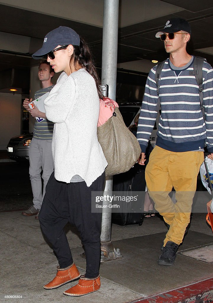 Rachel Bilson and Hayden Christensen are seen at LAX on June 19, 2014 in Los Angeles, California.