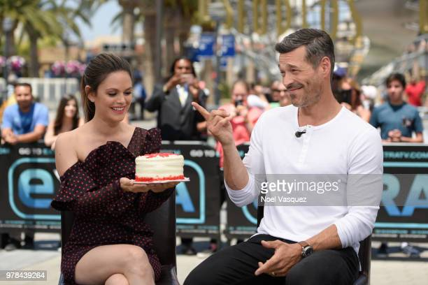 Rachel Bilson presents Eddie Cibrian a birthday cake at 'Extra' at Universal Studios Hollywood on June 18 2018 in Universal City California