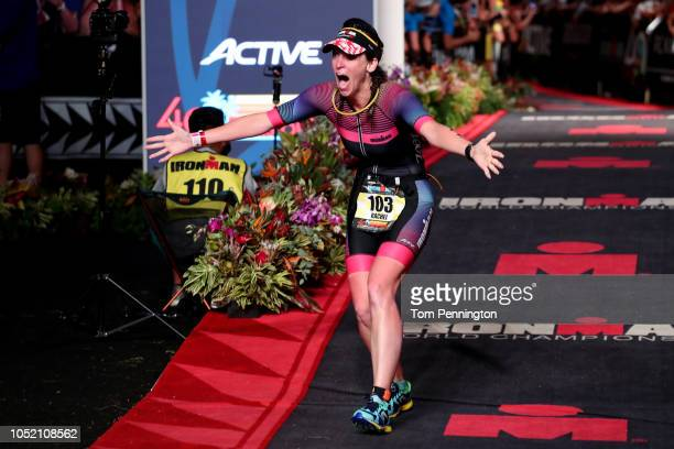 Rachel Brenke of the United States celebrates after finishing the IRONMAN World Championships brought to you by Amazon on October 13 2018 in Kailua...