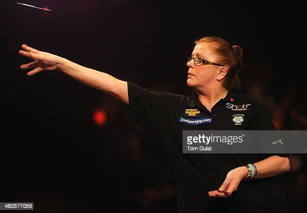Rachel Brooks of England in action against Ann Louise Peters of Denmark on day one of the BDO Lakeside World Professional Darts Championships at...
