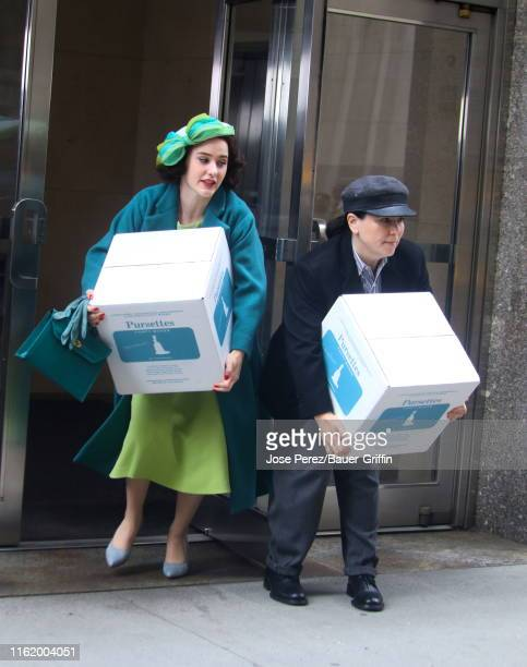 """Rachel Brosnahan and Alex Borstein are seen loading boxes into a cab as they film a scene of """"The Marvelous Mrs Maisel"""" on August 16, 2019 in New..."""