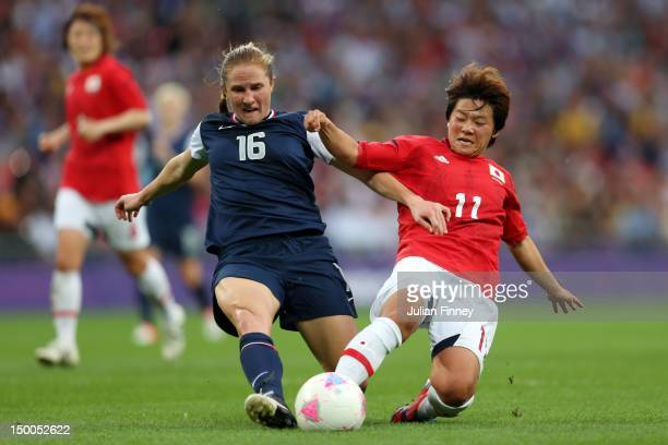 Rachel Buehler of United States and Shinobu Ohno of Japan go after the ball in the first half during the Women's Football gold medal match on Day 13...