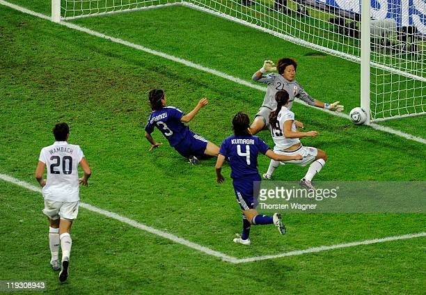 Rachel Buehler of United States battles for the ball with Ayumi Kaihori of Japan during the FIFA Womens's World Cup Final between the United States...