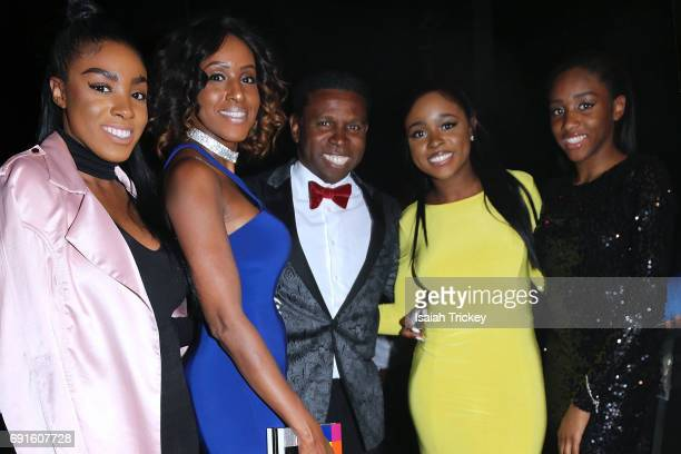 Rachel Clemons Diane LeeClemons Michael 'Pinball' Clemons Rylie Clemons and Raven Clemons attend the Victory Charity Ball at CBC Toronto on June 1...