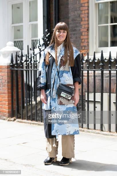 Rachel Cooper wears a Liam Hodges jacket, Craig Green trousers, Prada bag, Zara shoes and a vintage shirt during London Fashion Week Men's June 2019...