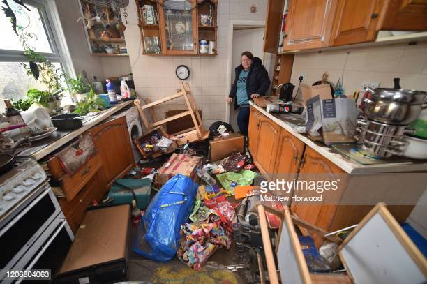 Rachel Cox stands among debris left inside her house after the floodwaters receded on Oxford Street on February 17 2020 in Nantgarw United Kingdom A...