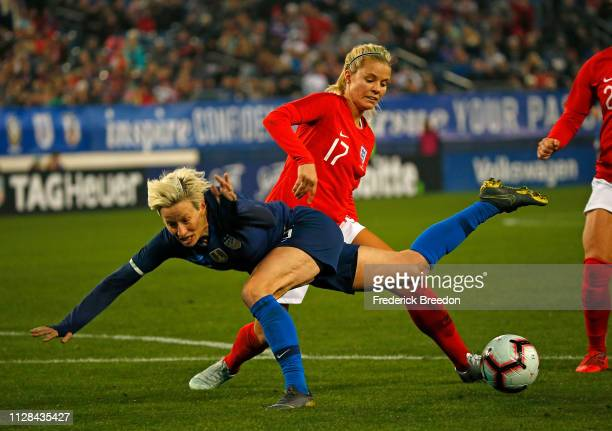 Rachel Daley of England collides with Megan Rapinoe of the United States during the second half of the 2019 SheBelieves Cup match between the United...