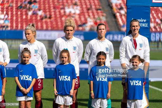 Rachel Daly, Millie Bright, Carly Telford and Jill Scott of England stand for introductions during a game between England and Spain at Toyota Stadium...