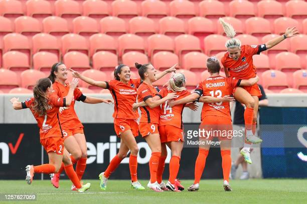 Rachel Daly of Houston Dash celebrates with her teammates after scoring a goal in the 69th minute against the Portland Thorns FC during the second...