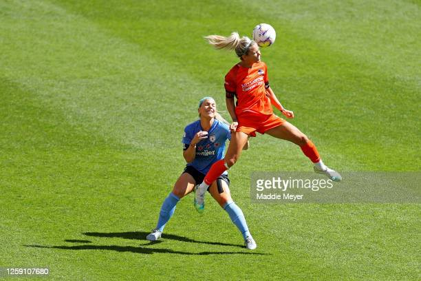 Rachel Daly of Houston Dash heads the ball over Julie Ertz of Chicago Red Stars during the first half in the championship game of the NWSL Challenge...