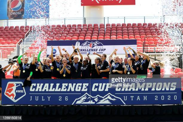 Rachel Daly of Houston Dash hoist the trophy with her teammates after defeating the Chicago Red Stars to win the championship game of the NWSL...