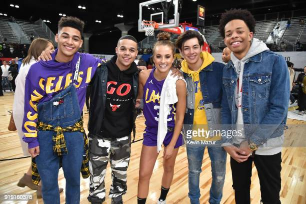 Rachel DeMita and musical group 4th Ave pose during the NBA AllStar Celebrity Game 2018 presented by Ruffles at Verizon Up Arena at LACC on February...